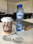 coffee of latte, bottle of water
